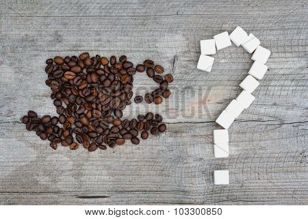 Coffee beans cup and sugar cubes