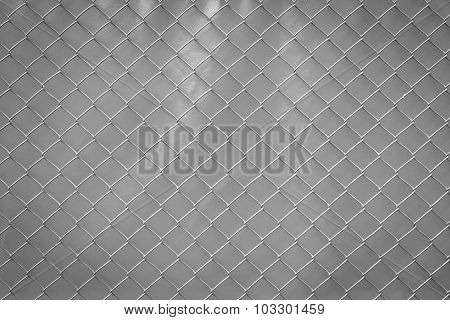 Steel Mesh Rusty On Grey Background.