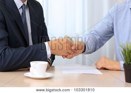 Handshake Of Businessmen With Money