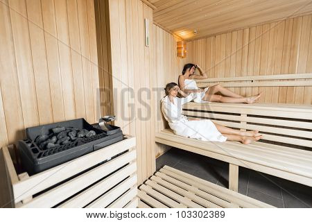 Sauna Heater And Girls Relaxing