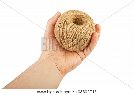 Hand holding hank of twine. Isolated on white background