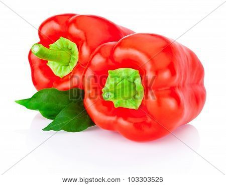 Two Bell Red Peppers With Green Leaves Isolated On White Background