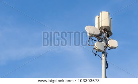 Telecommunications Tower With Clear Blue Sky Background.
