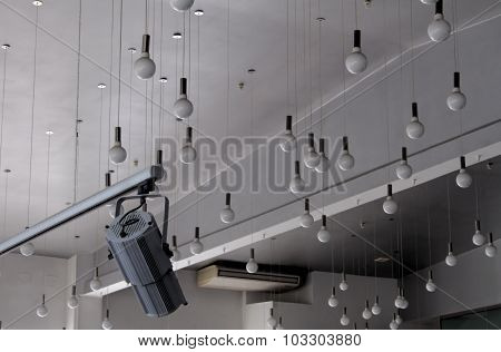 Round ceiling lamps and track spotlight for studio lighting