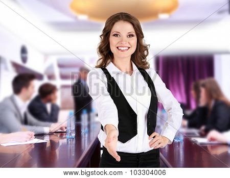 Businesswoman giving his hand for a handshake and business people