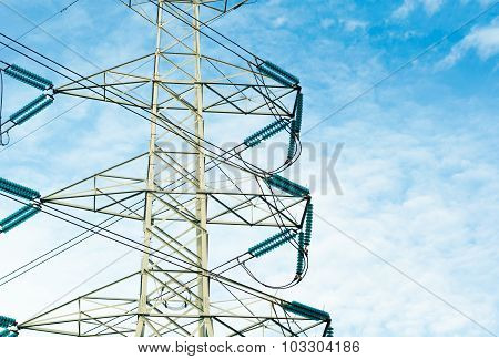 High Voltage Transmission Lines Isolated On Blue Sky Background