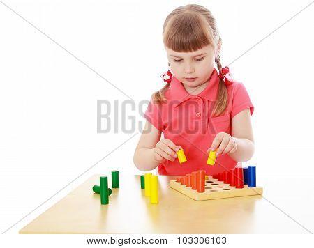 Girl in a Montessori environment