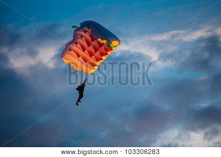 Skydiver On Colorful Parachute In Sky