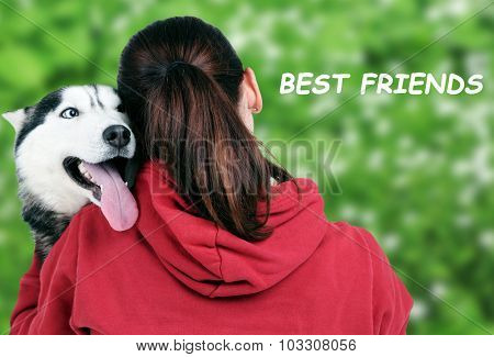 Woman and cute husky on nature background