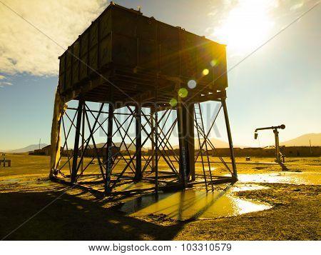 Vintage railroad water tank and pump