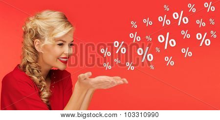 people, holidays, sale, shopping and advertisement concept - lovely woman in red clothes holding something on palms of her hands over red background with percentage signs