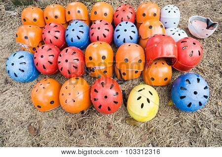 A Bunch Of Outdoor Adventure Safety Helmet On The Ground.