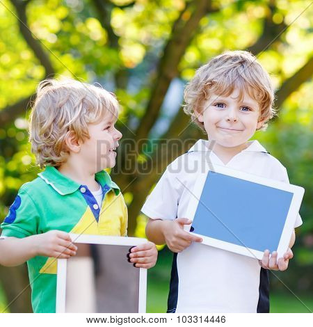 Two Funny Little Kids Happy Abount Tablets Pc