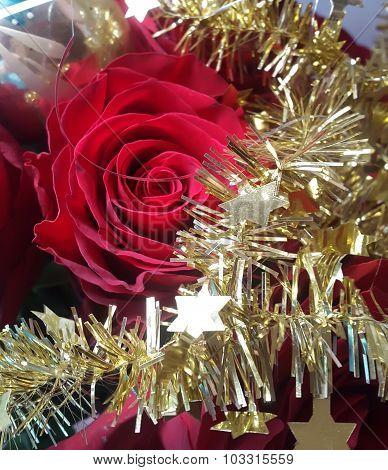 Christmas decoration red rose and gold garland