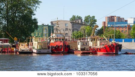 Small Industrial Boats Are Moored On River