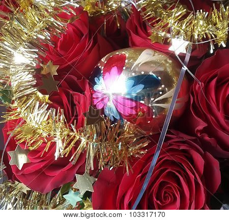 Christmas glass ball and natural red roses