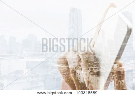 Double exposure image of people using smart phone