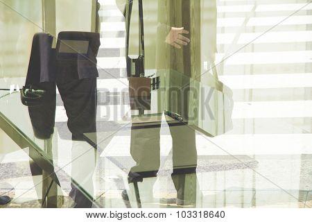 Multiple exposure image of businessman