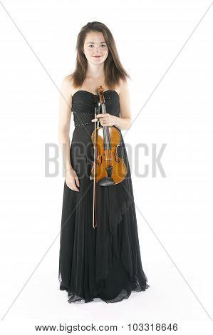 Brunette Holds Violin In Studio Against White Background