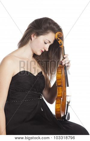 Pensive Female Violinist In Black Dress Against White Background