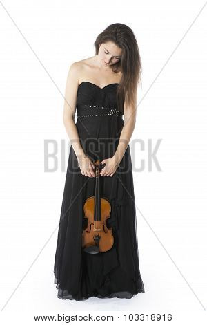Brunette Stands And Holds Violin In Studio Against White Background