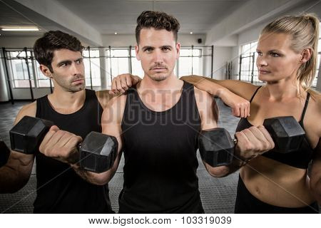 Fit people front the camera in crossfit gym