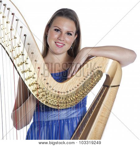 Young Caucasian Woman With Concert Harp In Studio Against White Background