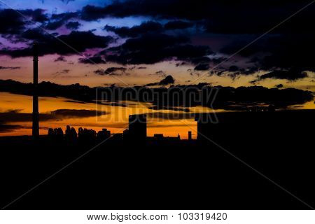 Urban dramatic skyline, silhouette, colorful sky, moody and dark