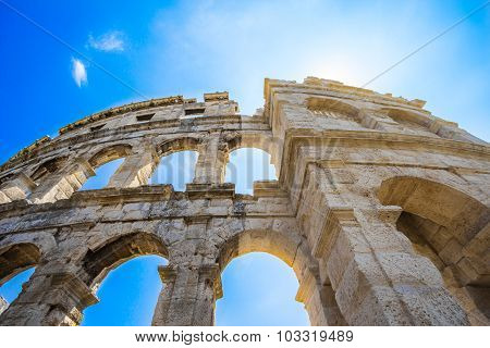 Ancient Roman Amphitheater in Pula, Croatia. Famous tourist destination.