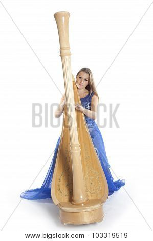 Young Caucasian Woman Sits And Plays Concert Harp In Studio Against White Background