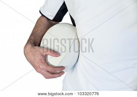 Midsection of player holding rugby ball over white background
