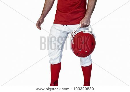Midsection of athlete holding rugby helmet over white background