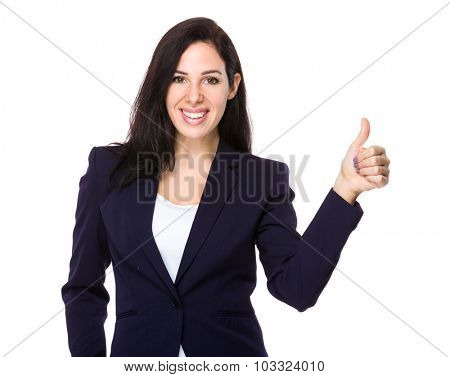 Caucasian businesswoman with thumb up