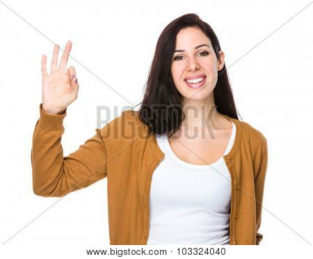 Beautiful woman with ok sign gesture