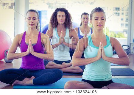 Focused women in fitness studio doing easy pose