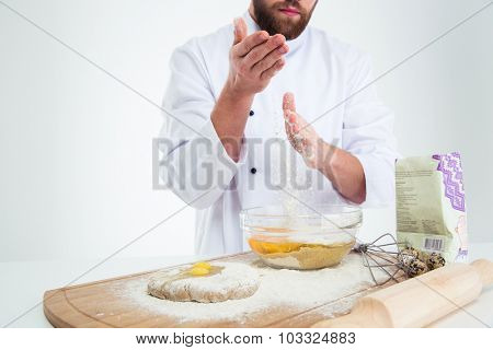 Closeup portrait of a male hands preparing dough for pastry