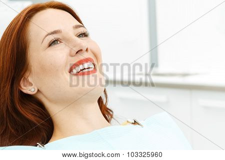 Beautiful girl on the dental chair