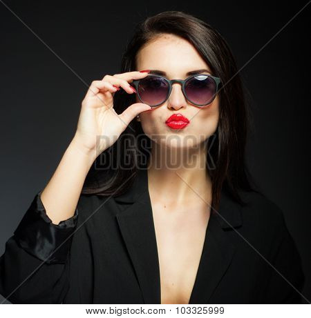Glamour Woman With Sunglasses, Jacket And Red Lips