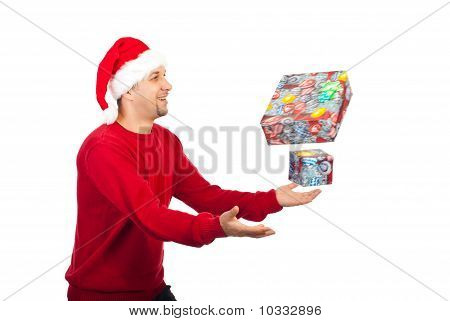 Happy Man Trying To Catch Christmas Gifts