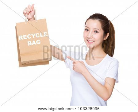Woman finger point to shopping bag and showing phrase of recycyle bag