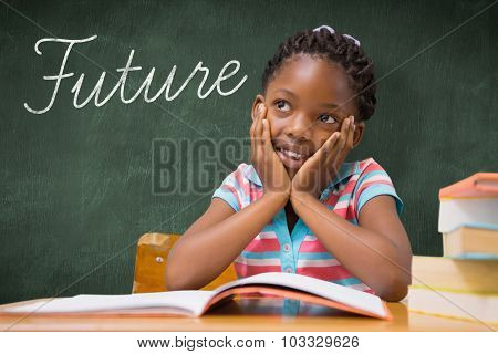 The word future and pupil sitting at her desk against green chalkboard
