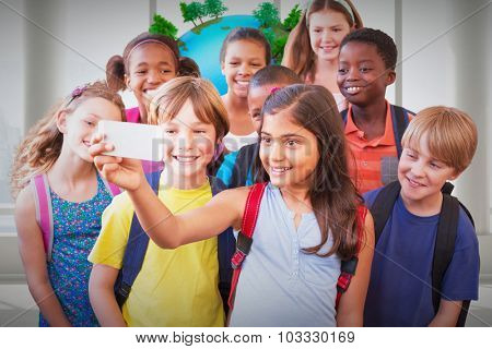 Cute pupils using mobile phone against earth floating in room