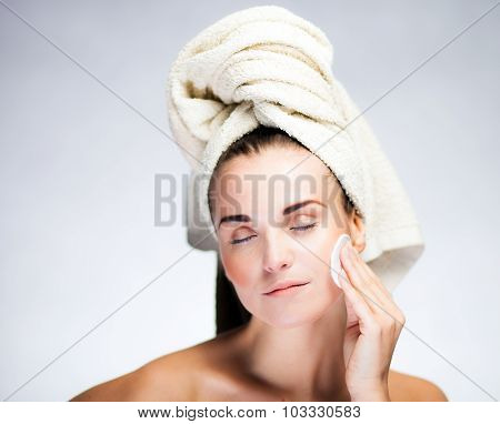 Fresh Girl Cleaning Face With Cotton Swab