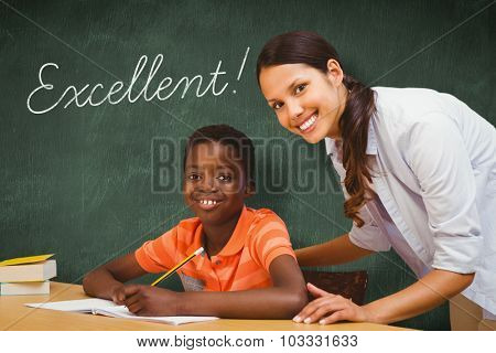 The word excellent! and teacher assisting boy with homework in library against green chalkboard