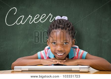 The word career and smiling pupil sitting at her desk against green chalkboard