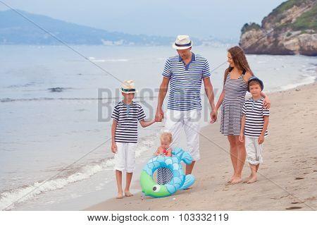 Portrait Of Happy Beautiful Family Near  Sea