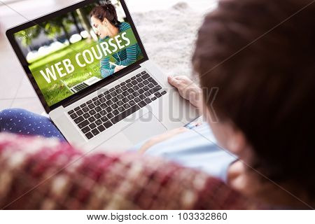 Pregnant woman using her laptop against web course ad
