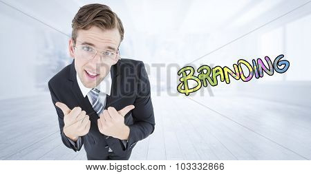 Geeky businessman with thumbs up against city scene in a room