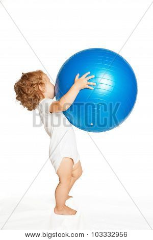 Baby Playing With A Large Fitness Ball.