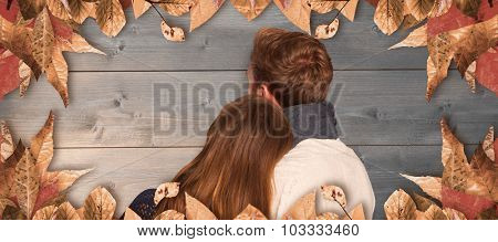 Close up rear view of romantic couple against bleached wooden planks background